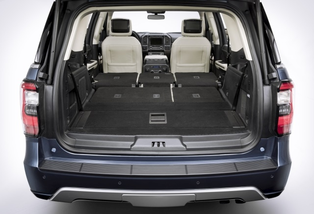 The 2018 Expedition is available in two wheelbase options — the standard Expedition and Expedition Max. With the second- and third-row seats folded flat, the standard Expedition has a cargo volume of 104.6 cubic feet and the Expedition Max has 121.4 cubic feet. The fold-flat floor creates space large enough to haul sheets of plywood with the liftgate closed. (Photo: Ford Motor Co.)