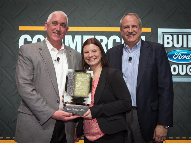The 2017 Medium-Duty Truck of the Year award was presented to John Ruppert, Ford general manager, commercial vehicle sales and marketing (left) and John Scholtes, Ford chief program engineer, commercial vehicles (right) by Lauren Fletcher, executive editor of WT. (Photo courtesy of Ford Motor Co.)