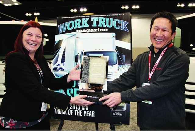The Medium-Duty Truck of the Year award was presented to Hisao Sasaki, president & COO of ICTA (right) by Lauren Fletcher, managing editor of Work Truck magazine at the 2013 Work Truck Show held in March 2013 in Indianapolis.