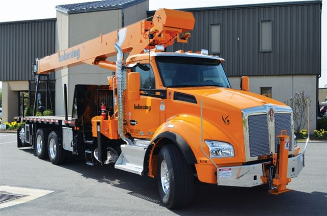The newest Kenworths in the construction firm's fleet are T880s, like this multi-axle flatbed truck with a National 27-ton on-board crane. They carry and lift materials and mechanical equipment at heavy bridge and industrial projects, and engines run hydraulic pumps to operate the cranes. Thus idle-reduction isn't always possible.