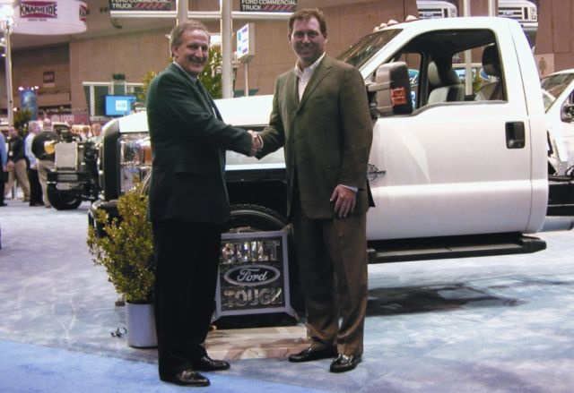 Len Deluca, director, Ford commercial trucks, sales and marketing, (left) accepts congratulations from Bob Brown Jr., Work Truck magazine associate publisher, on the Ford Super Duty's third consecutive recognition as Medium-Duty Truck of the Year. The 2010 award winner was announced at the recent NTEA Work Truck Show in St. Louis.