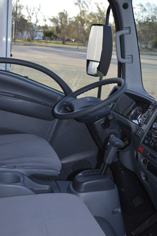 The driver's seat is supportive, and shifter and parking brake are conveniently close by. Gauges are few but adequate, and three-knob HVAC controls are easy to use. Visibility and maneuverability are excellent.