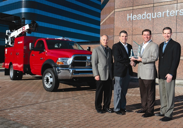 Work Truck magazine Associate Publisher Robert Brown (second from right) presents the 2011 Medium-Duty Truck of the Year Award to the Ram Chassis Cab team, (left) Joe Veltri, vice president, Product Planning; Fred Diaz, president and CEO Ram Truck Brand and head of National Sales; and Scott Kunselman, senior vice president, Engineering. Shown in back is the 2011 Ram 4500 Chassis Cab.
