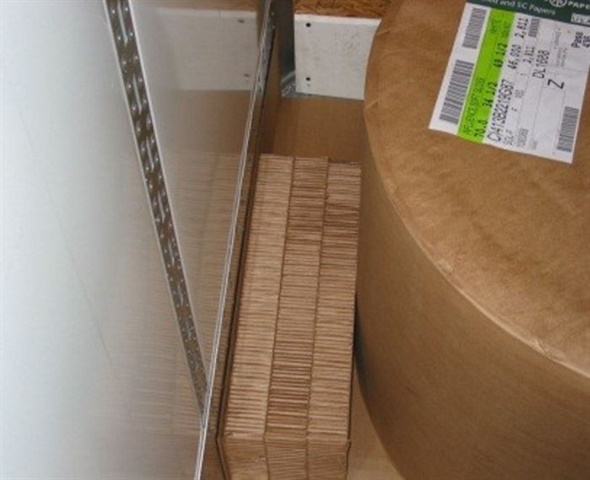 Void filler braces the paper roll against the sidewall's scuff plate and keeps the load from shifting during turns.
