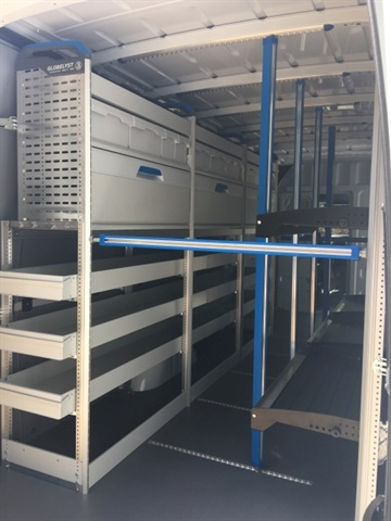 On the street side, the van provides storage for long components and tools, while curbside the driver has access to Flexx Rack shelving that can fold away if more space is needed. (Photo: Sortimo)