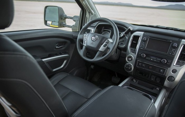 The Pro-4X interior is middle of the line; there are two plainer and two fancier trim levels. The in-dash screen can show an image from a rear-pointing camera plus a simulated bird's-eye view that reveals obstacles around the truck.