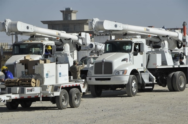Photo of utility fleet trucks courtesy of Wikimedia/USCAE-TAS