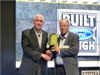 John Ruppert (L), general manager –  Commercial Vehicle Sales & Marketing at Ford Motor Company, accepts the award for the F-650/F-750 from Work Truck's Editor & Associate Publisher, Mike Antich, at a ceremony during the 2016 NTEA – Work Truck Show. (PHOTO: Chris Brown)