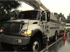 Fleet vehicles from Florida Power & Light take part in storm response training, including demonstrating efficient field work to restore power. (PHOTO: FPL)