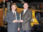 Len DeLuca (left), director of Ford Commercial Trucks, accepts the Medium-Duty Truck of the Year award from Work Truck magazine Associate Publisher Bob Brown at the National Truck Equipment Association's 2008 Work Truck Show in Atlanta.