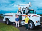 (L-R) Kelvin Kohatsu, Hawaii Electric Light fleet administrator; Joshua Kunimura, Hawaii Electric Light apprentice service lineman; and Clyde Kunimura, Hawaii Electric Light senior service lineman stand on and next to a Kenworth T300 bucket truck. (PHOTO: Zonar)