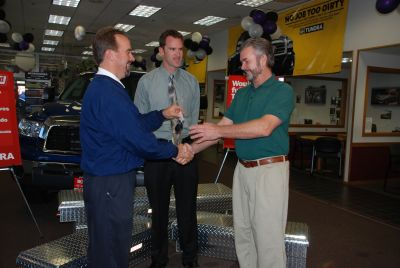 Bruce Miller (left-right) and Geoff Schick, WEATHER GUARD, presents the keys to a 2007 Toyota Tundra outfitted with WEATHER GUARD truck equipment to Boulder, Col. resident, Steve Hargreaves (right).