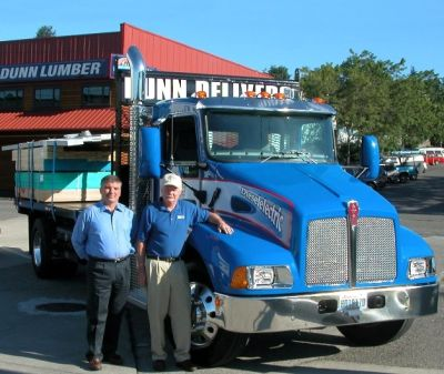 From left are Mark Geyer and Dunn Lumber fleet manager, with the company's new Kenworth medium duty hybrid truck for pickup and delivery application.