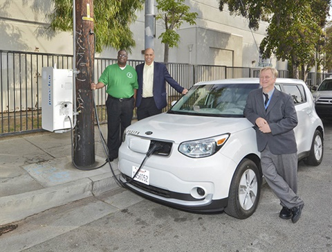 Watts Neighborhood Council President Mac Shorty, Board of Water and Power Commissioners Vice President William Funderburk and LADWP Director of Power Engineering Marvin Moon charge up an electric vehicle at the new pole mounted EV charger in Watts. Photo courtesy of LADWP