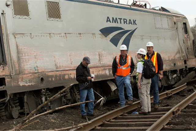 NTSB investigators at scene of Amtrak derailment in Philadelphia on May 12 that killed eight passengers and injured another 200. Photo: NTSB
