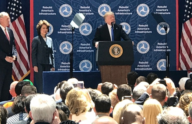President Trump making remarks at U.S. DOT headquarters on June 9, 2017, as Secretary of Transportation Elaine Chao looks on. Photo: U.S. DOT