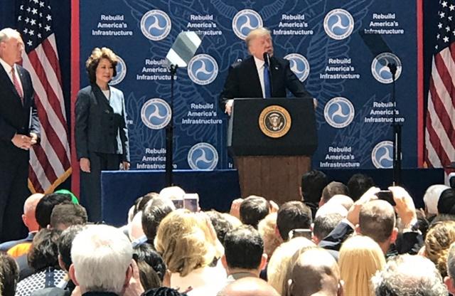 President Trump making remarks at U.S. DOT headquarters on June 9, 2017, as Secretary of Transportation Elaine Chao looks on. Photo: U.S. DOT
