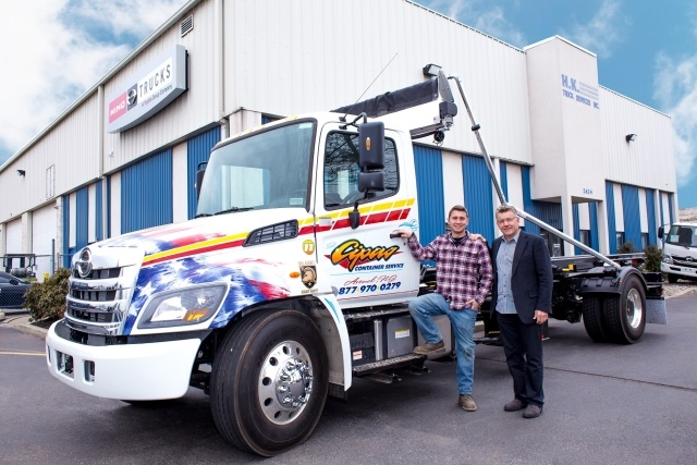 The 1,000th truck is a 2018 Hino 338 outfitted with an American Roll-Off container body. (Photo courtesy of Hino)