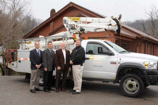 Bob Shurtleff, right, Kentucky Power's customer services and distribution manager in Pikeville, donates a bucket truck slated for retirement to the University of Pikeville. Also pictured, from left, representatives from the University of Pikeville including, David Hutchens, vice president for advancement and alumni relations; Burton Webb, president; and John Holman, assistant vice president for facilities management. (PHOTO: University of Pikeville)