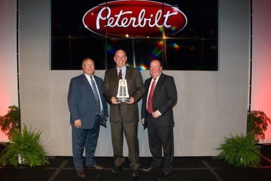 Doug Danylchuk, dealer principal of Peterbilt Manitoba, accepted the award at Peterbilt's annual Dealer Meeting.