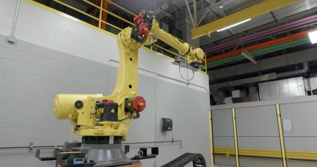At Nissan Technical Center North America (NTCNA) in Michigan, Mrs. Doorboto – also known as Rosie, is the door-slammer-in-chief. In just three days, without need of a coffee break, the 1.5-ton robot opens and closes a door as often as a typical customer would in 10 years. (Image couertesy of Nissan Motor Co.)