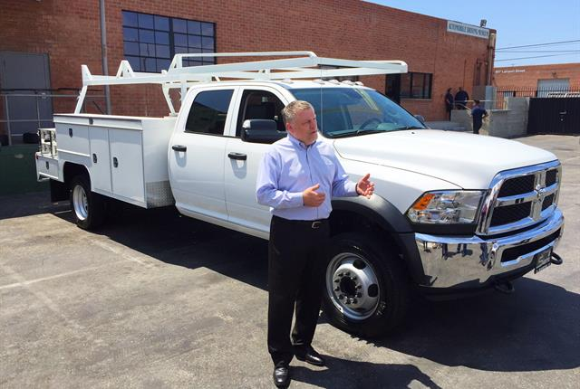 Dave Sowers, head of Ram Truck marketing, commercial vehicles, shows journalists the 2017 Ram 4500 chassis cab truck. Photo by Paul Clinton.
