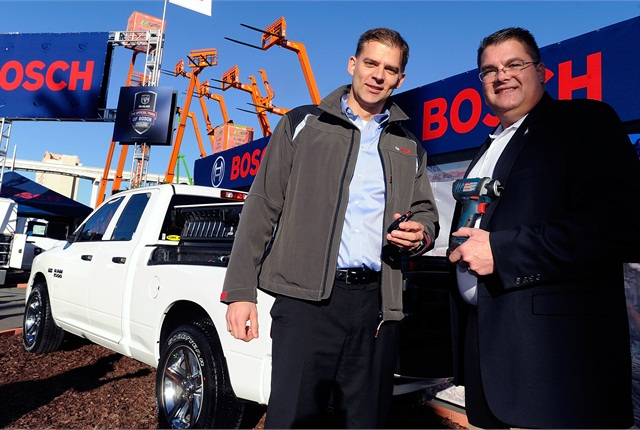 "Christian Heine, president, Bosch Power Tools North America (left) and Bob Hegbloom, director, Ram Truck Brand (right), name Ram the ""Official Truck of Bosch Power Tools & Accessories"" today during the World of Concrete trade show. (PRNewsFoto/Bosch Power Tools)"