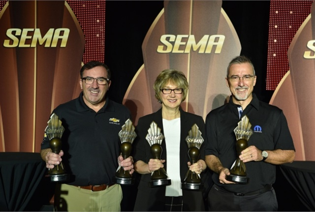 (From left) Alan Batey, president, GM North America; Judy Curran, Ford Motor Co. director, planning & strategy-vehicle components and systems; Pietro Gorlier, head of parts and service, MOPAR, FCA display their proudly won awards. (Photo courtesy of PR Newswire)