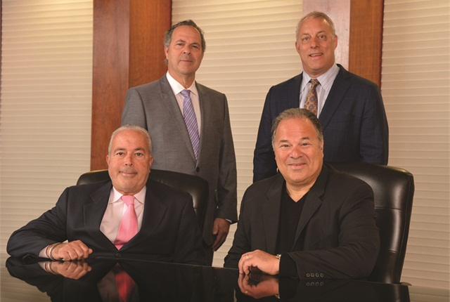Merchants' owners (clockwise from upper left) Jeffery Singer, Michael Sydney, Gary Singer, and Robert Singer