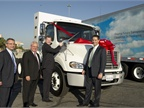 <br />Scott Perry, vice president, supply management, fleet management solutions for Ryder Logistics & Transportation Services Worldwide cuts the ribbon on Daimler Trucks North America 1,000th natural gas truck.