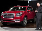 GMC U.S. Marketing Vice President Tony DiSalle unveils the 2013 GMC Acadia at the Chicago Auto Show Wednesday, February 8, 2012 in Chicago, Ill. The Acadia features a new exterior and the industry's first front center air bag system, created to protect drivers and front passengers in far-side impact crashes. (Photo by Tyler Mallory for GMC)