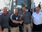 Image Caption - Pictured from left: Vince Tiano - Vice President of Miller Industries; Aaron Forron – Winner Sprint Towing; Will Miller- President and Co-CEO of Miller Industries; and Gary Mickiewicz, Vice President, Eastern Region of Hino Trucks.