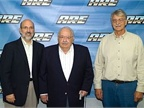 (L to R) Ralph Gatti and Aden Miller, who both received the LTAA Hall of Fame Award at the 2011 SEMA Show, surround A.R.E. co-founder Sal Gatti.