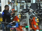 Photo of worker building EcoBoost at Cleveland Engine Plant courtesy of Ford.