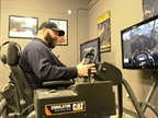 Photo by David Kligman.PG&E instructor Jerry Hall demonstrates a video game-like simulator that teaches employees how to safely operate large digging machinery.