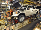 A Ford F-150 is being assembled at the automaker's Kansas City Assembly Plant. Ford is adding 2,000 jobs to meet F-150 demand and to build the all-new Ford Transit.