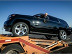 Photo of 2015 Chevrolet Tahoe being loaded for delivery courtesy of GM.