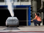 An aerodynamics engineer tests airflow over a Chevrolet Cruze 40-percent scale model in Reduced Scale Wind Tunnel. Photo courtesy of GM.