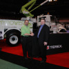 At The Work Truck Show 2010, the Terex Utilities HyPowerTM Hybrid system won The Work Truck Show Green Award for innovation in fuel utilization. Here, Steve Carey, National Truck Equipment Association (NTEA) senior director of operations, congratulates Terry Vanconant, Terex Utilities marketing communications and promotions coordinator (left) in the Terex booth.