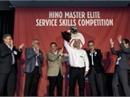 Billy Stanley of Rush Truck Center - Houston raises the cup as the winner of Hino Truck's 2017 National Master Elite Service Skills Competition. (Photo: Hino Trucks)