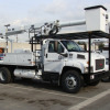 The new Altec Industry aerial bucket trucks operate on propane and are expected to save $60,000 in annual fuel costs.