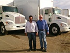 Altman's Leo Napoles, distribution and customer service manager, and Jim Hessler (right) stand in front of the new T270s. Photo courtesy of Kenworth.