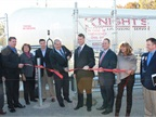 A ribbon-cutting ceremony welcoming new ROUSH E-350 vans to Knight's Airport Limousine Service's fleet.