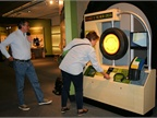 Visitors interact with Yokohama Tire Corporation's exhibit at the Museum of Science, Boston.