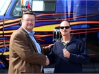 Houston area driver Jim McCauley receives the keys to an International ProStar from Danny Thomas of Navistar as the winner of the OnCommand Connection Sweepstakes. (Photo courtesy of Navistar)