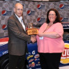 Dennis Selle, PepsiCo Global Procurement / Strategy Supply Manager Fleet Procurement, presents the 2010 PepsiCo Piston Cup to ARI's Kelli Auchenbach