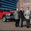 :  Work Truck magazine Associate Publisher Robert Brown (second from r.) presents the Ram Chassis Cab team with the 2011 Medium-Duty Truck of the Year Award. From left, Joe Veltri, vice president -- Product Planning; Fred Diaz, president and CEO Ram Truck Brand and head of National Sales; and Scott Kunselman, senior vice president -- Engineering. Shown in back is the 2011 Ram 4500 Chassis Cab.