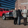 Work Truck magazine Associate Publisher Robert Brown (second from r.) presents the Ram Chassis Cab team with the 2011 Medium-Duty Truck of the Year Award. From left, Joe Veltri, Vice President -- Product Planning; Fred Diaz, President and CEO Ram Truck Brand and Head of National Sales; and Scott Kunselman, Senior Vice President -- Engineering. Shown in back is the 2011 Ram 4500 Chassis Cab.