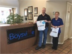 Dan Horton and Sue Perkins from Terex delivered 100 hygiene kits to Boysville in January. Photo courtesy of Terex