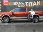 Fred Diaz, senior vice president, Sales & Marketing and Operations, U.S.A. at the Texas State Fair in front of the 2016 Nissan TITAN XD. (PHOTO: Nissan)
